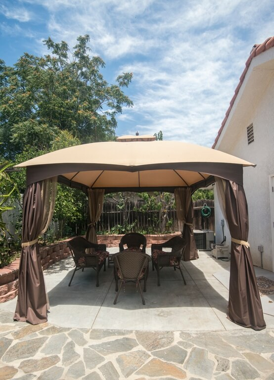 The slight curvature of this portable gazebo gives it a bit more style than you'd expect from a mostly canvas structure. Again, we see the double-layered curtains that can form the enclosed sides of the structure, if needed.