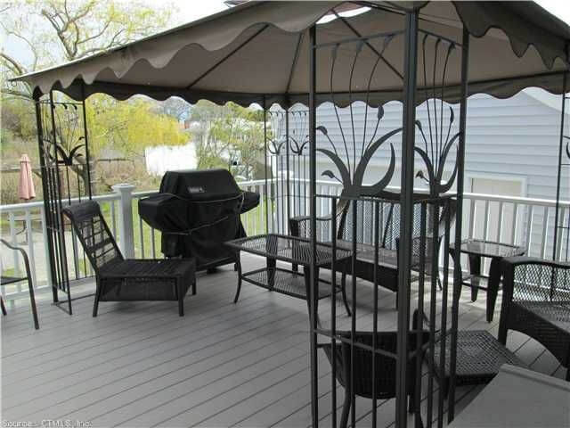 The designs on the supports of this gazebo add elegance to an otherwise simple gazebo structure. The scalloped edges of the canvas roof are a great touch.