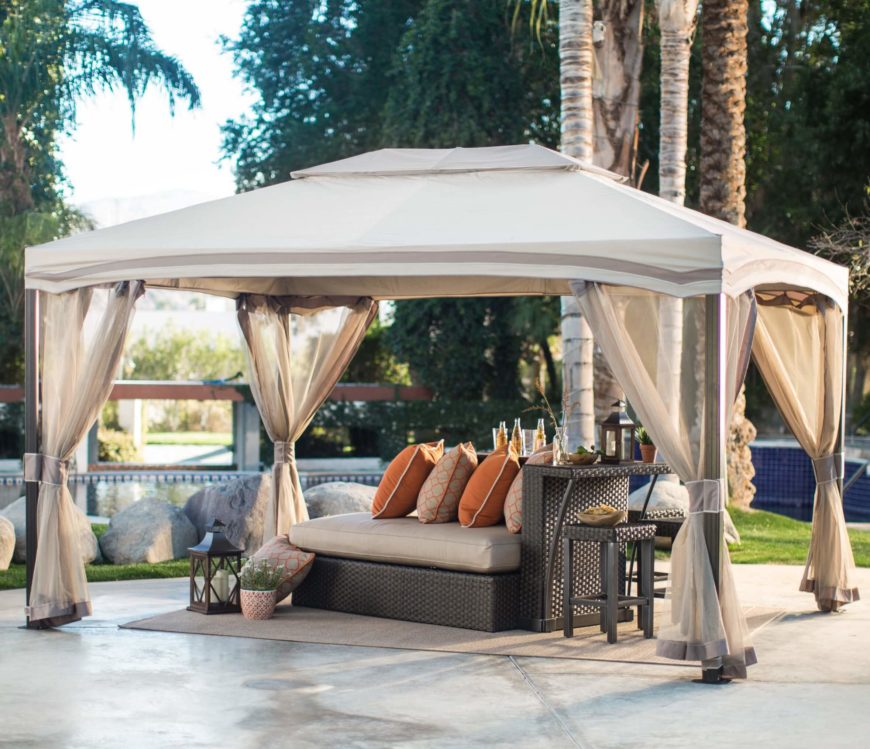 This spacious gazebo sits above a chaise lounge and outdoor bar combo by the pool. It's a great way to relax, and is easy to set up and take down when the season is over.
