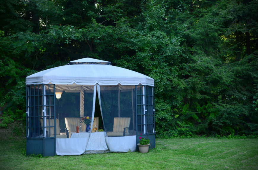 This gazebo is sizable and has a sturdy aluminum base. The screens can be pulled back to allow the breeze in during the day, and closed to prevent mosquitos and other insects from invading the gazebo in the evening hours.