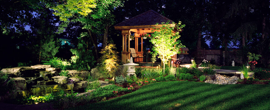Well lights brighten up this square gazebo. This comfortable area is a place you can hang out and socialize late into the night, or curl up and get lost in your favorite book.