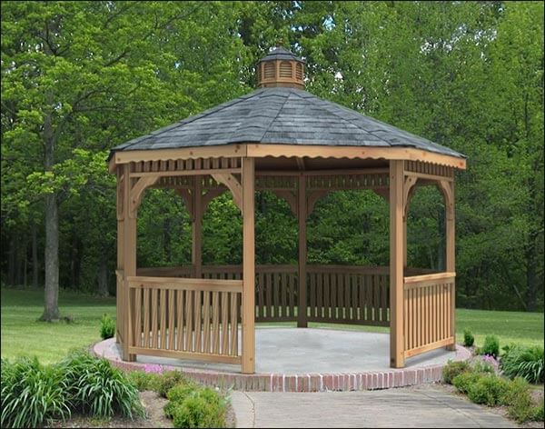 This wooden gazebo stands in the center of this yard, elevated on a bring and concrete base. It acts as a center point for the space and lets those that gather there wee everything in the yard while they kick back in the shade.
