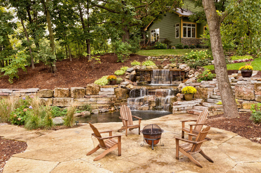 The owner of this cabin seems to have decided to bring nature closer to home by using landscaped rocks and stones to create man-made mini waterfalls. There's stoned pavement that leads from the cabin to the backyard garden where you can enjoy an outdoor picnic with family and friends while enjoying the view.
