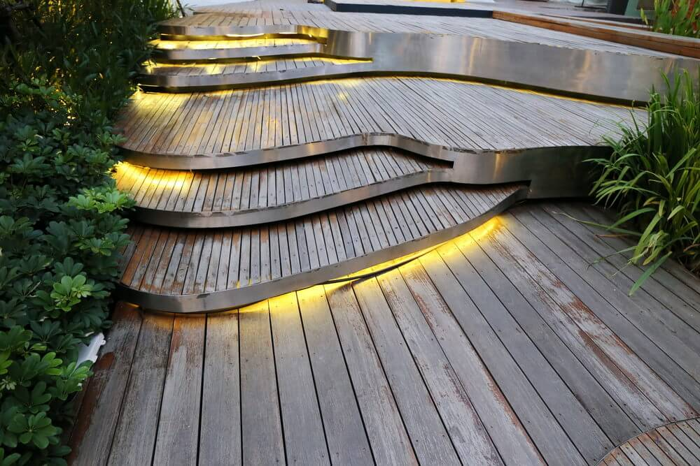 Backlit effects used outdoors make for an awesome nightglow and together with the piano-like look of these garden steps overall creates a modern and contemporary finish.