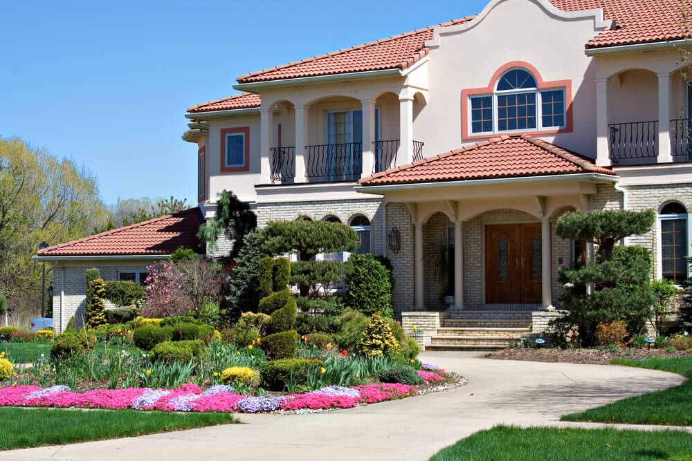 A landscape of class and style, where you find well-maintained grasses, trimmed plants and colorful blossoms.