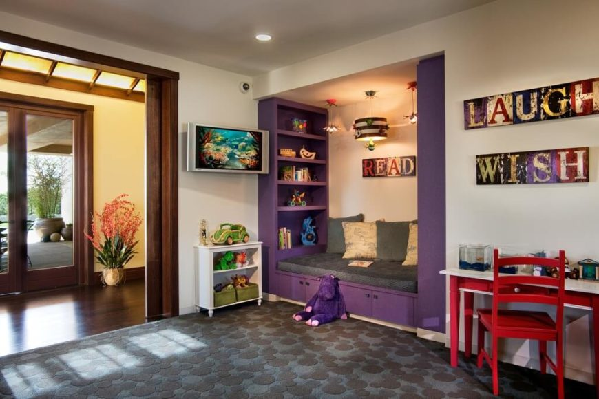 Here is a nice comfortable reading nook tucked away on the side of the room. The fun color makes it stand out and draws children into the space for an excellent time reading and learning.