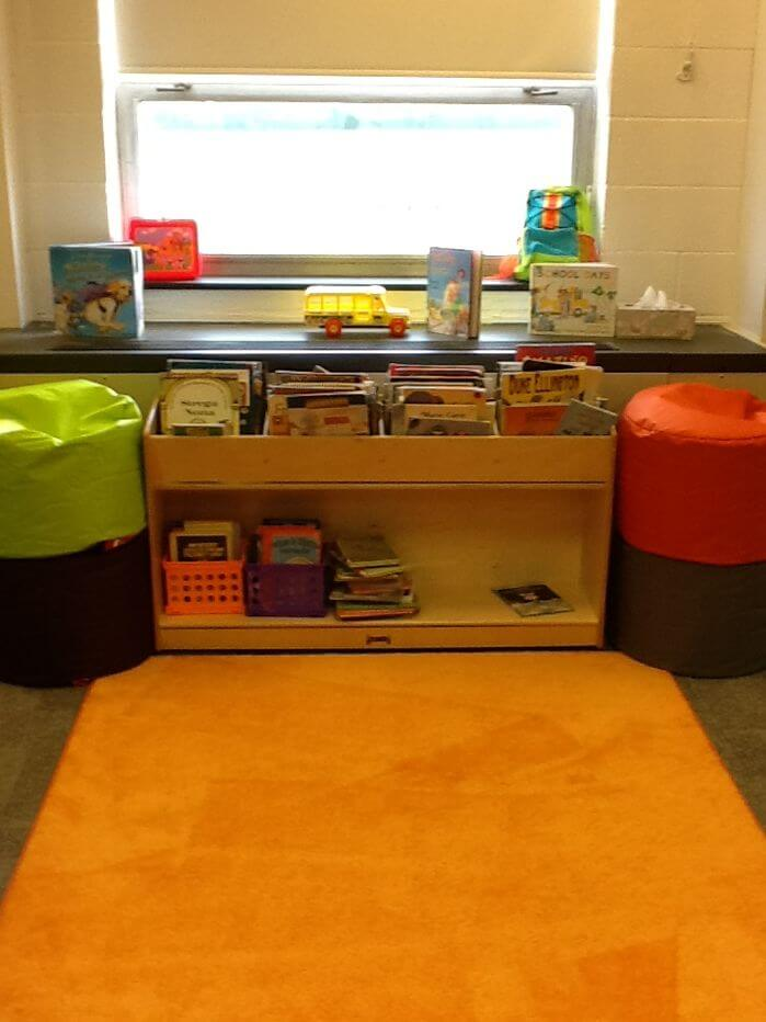 Kids also like sitting on the floor. This space is a tucked away reading space where you can lay on the ground and read a variety of fun picture books with your children.