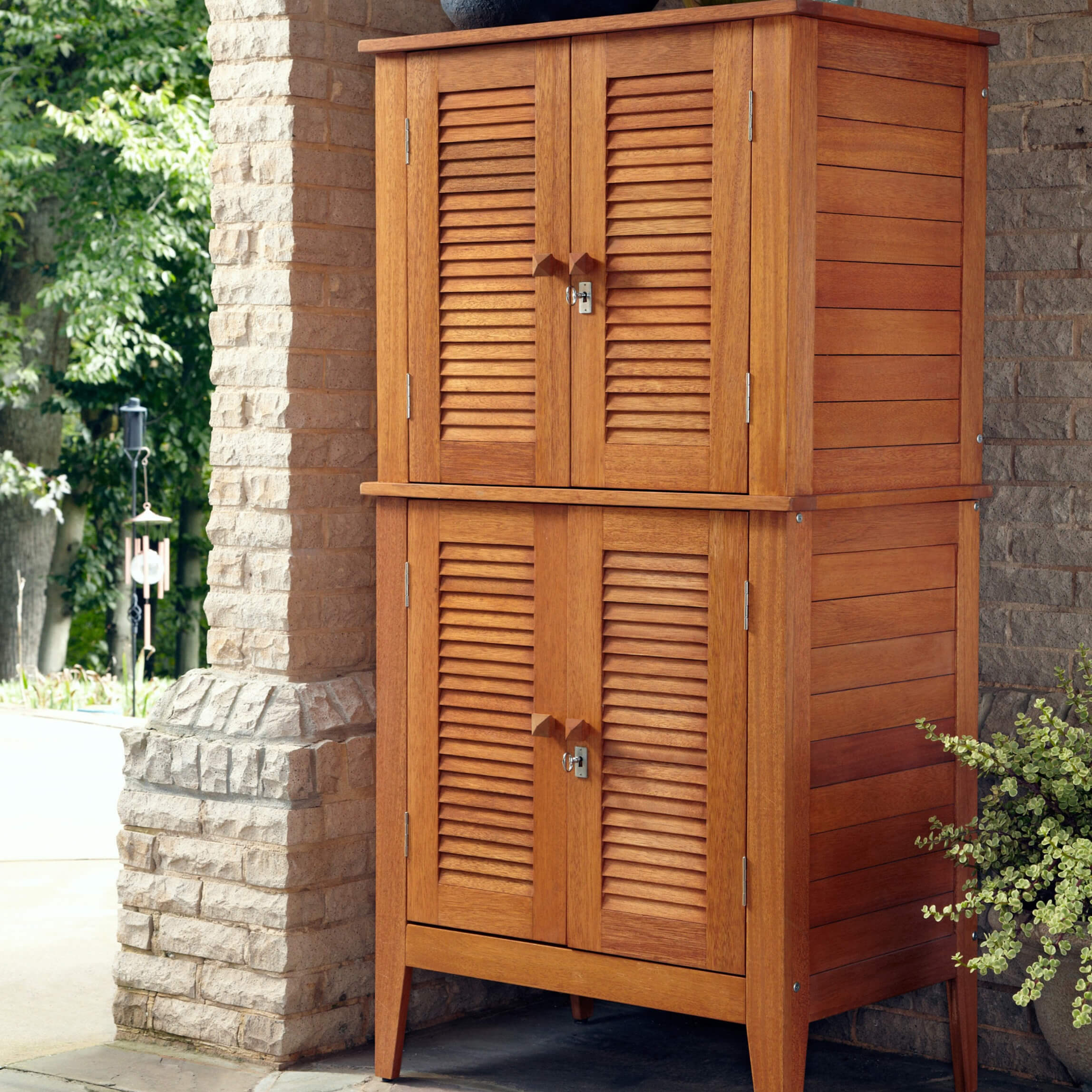 This beautiful and durable four-door storage cabinet is crafted out of eco-friendly Shore wood that is naturally water-resistant. The four double doors open to spacious shelves.