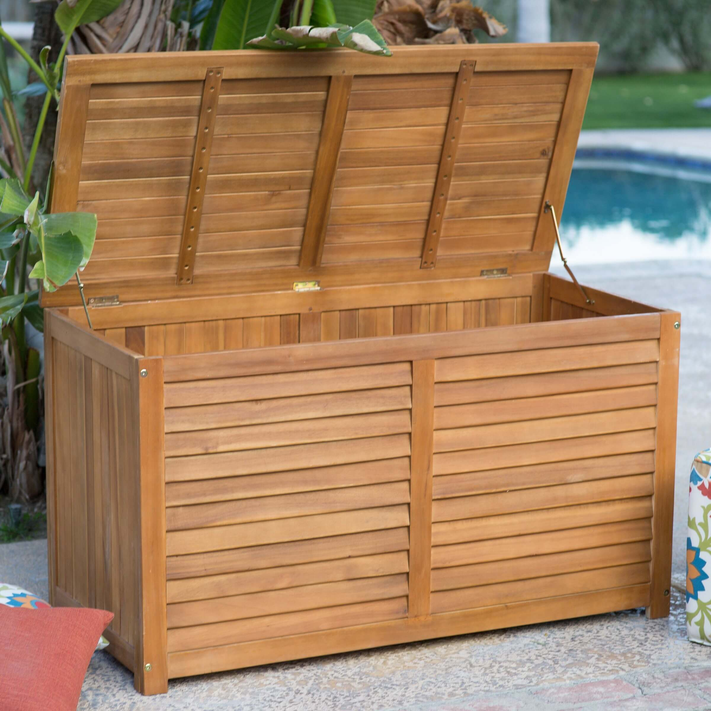 Designed with a slat construction for ventilation, this acacia wood storage box has a natural finish and lots of storage space.