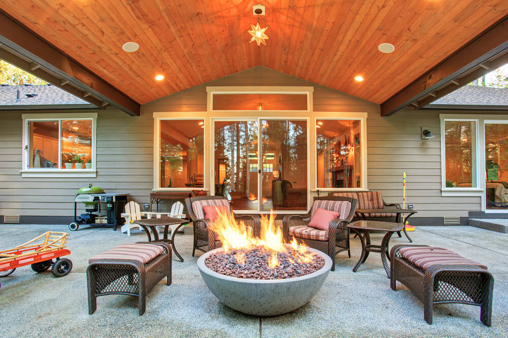 Round firepit in a covered patio.