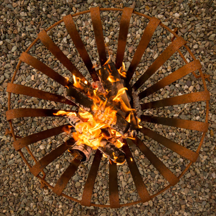 Overhead view of a small movable metal grate style fire pit.