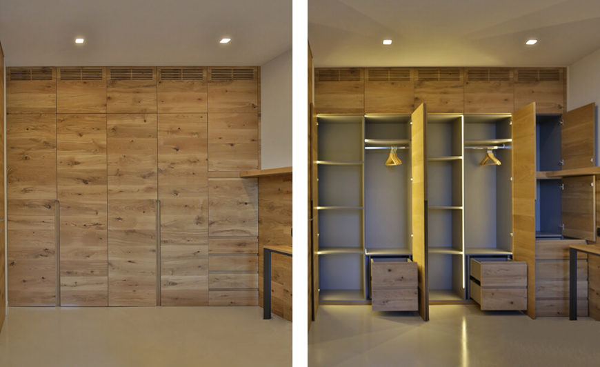 Massive closet area features nearly hidden door panels, popping open to reveal a variety of shelving and drawers, with built-in lighting.
