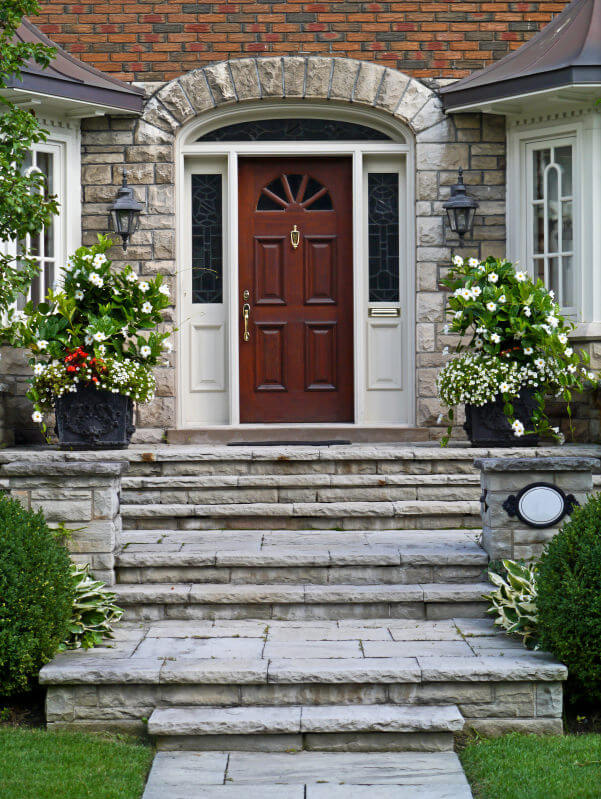 Imagine making your way up the steps while potted white flowers are standing and waiting on the upper level.