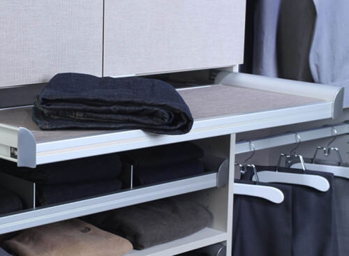 A very convenient way of organizing your clothes and linens is with this sliding folding board. You can slide it out when needed and slide it back when not in use. This is quite a space saver.
