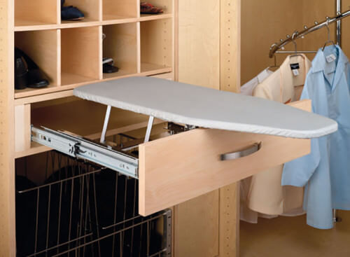Just slide the drawer out and a peek-a-boo ironing board comes out. This an amazing idea for small spaces.