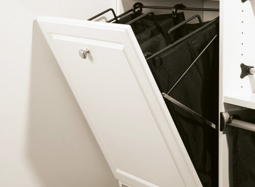 Another innovative design that gives your home an extra space to hide your laundry. This tilting hamper works by pulling the knob and a pair of black hampers come out.