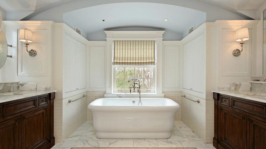 Elegant bathroom with dark brown (wood vanities), white, grey (ceiling) and very light tan.