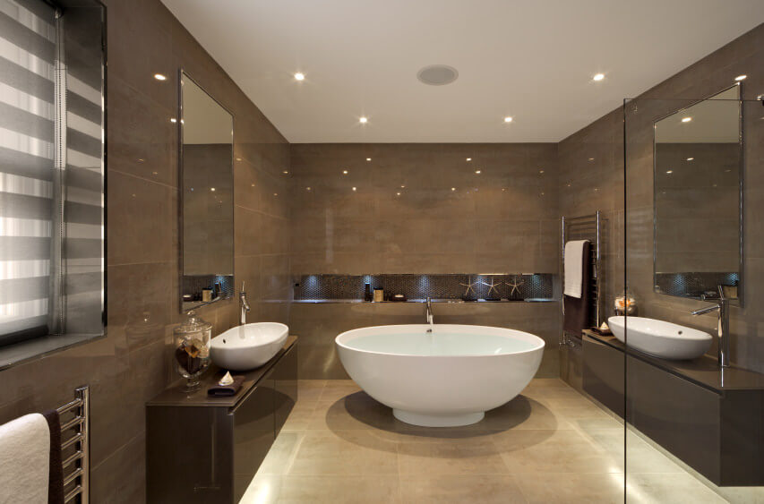 Contemporary designed bathroom with shimmering brown derby colored wall and tile vanities. White ceiling and sinks highlight the scheme.