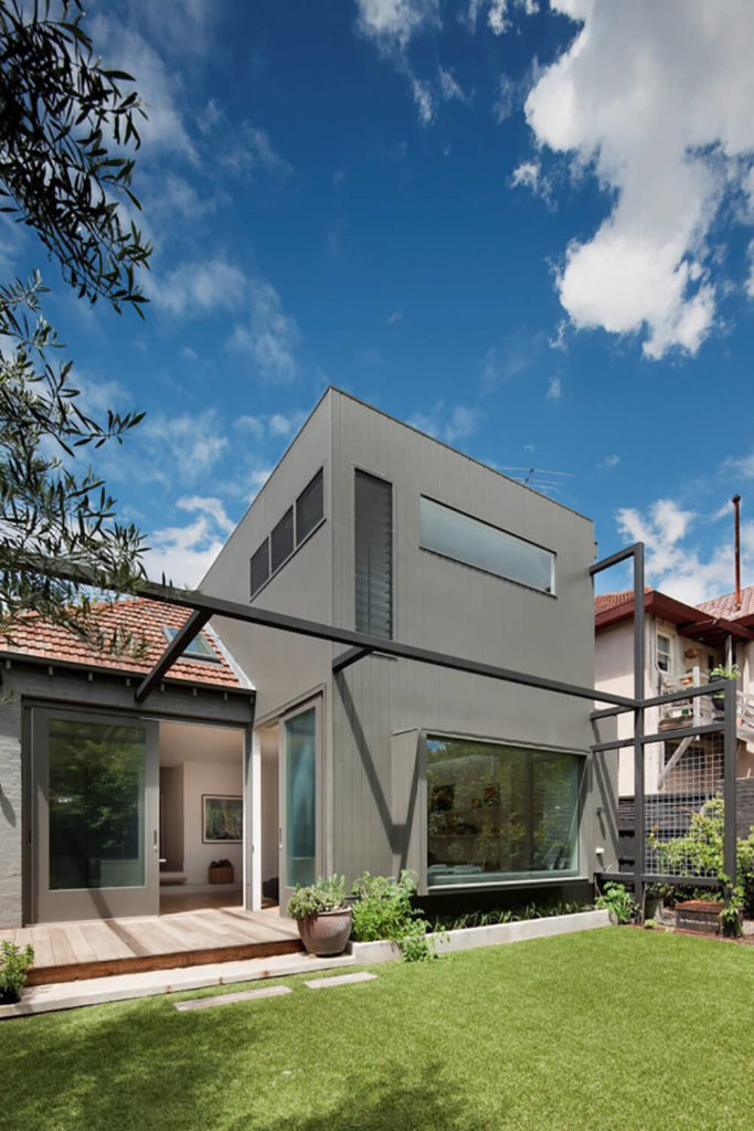 The exterior of the home is a more boxy, simple looking design, with a shape that conceals the broad, open plan design within.