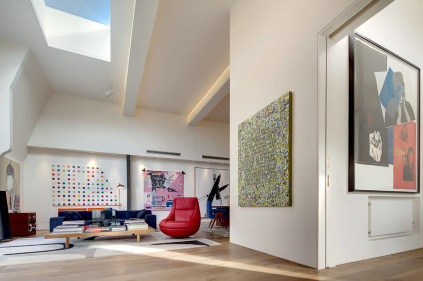 The raised ceilings really help give the interior a vast, open look, with plentiful natural light cascading throughout. The large white walls serve as the perfect backdrop for large and varied art pieces.