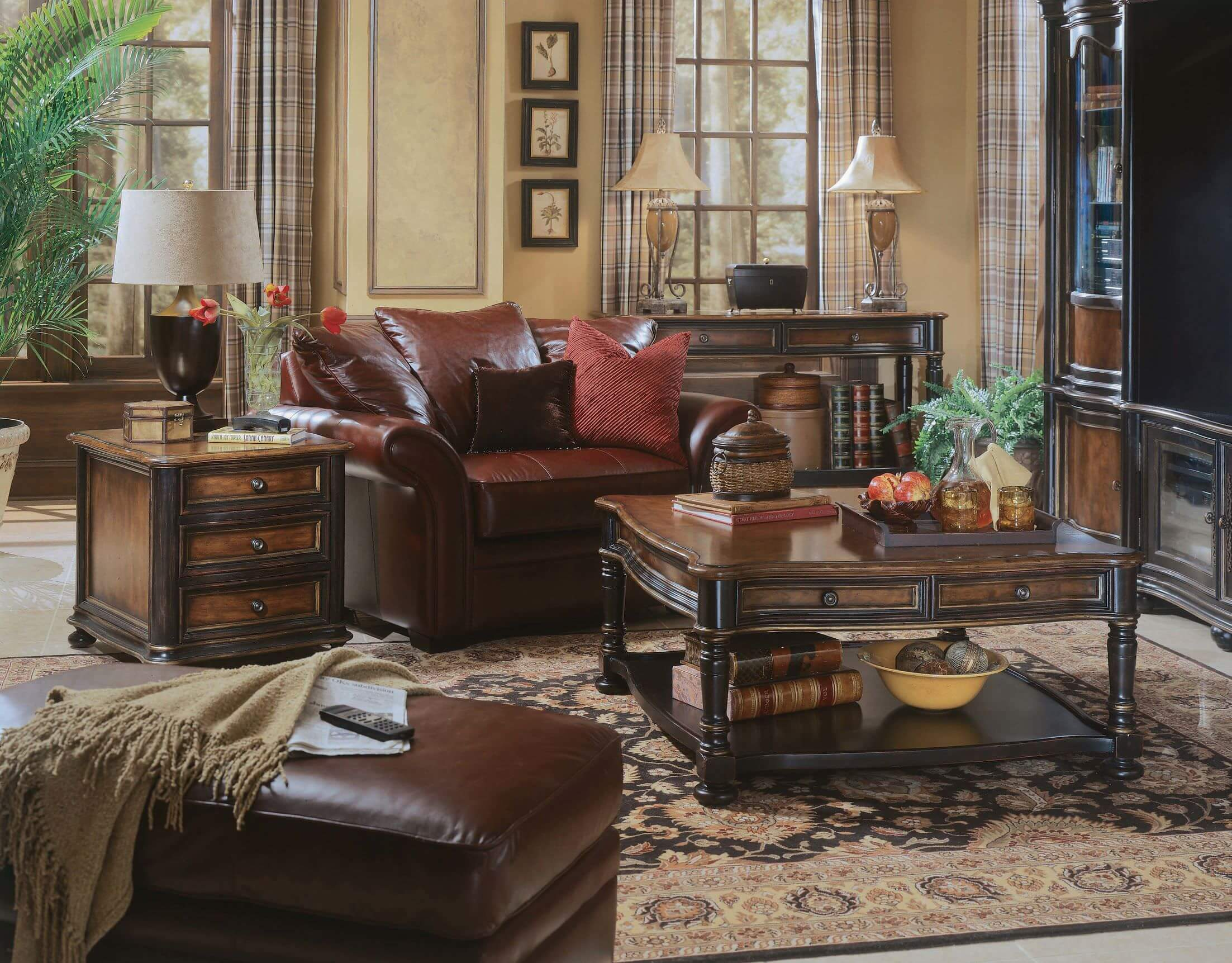 This living room features a wood tone. The room offers cozy seats and a classy area rug.