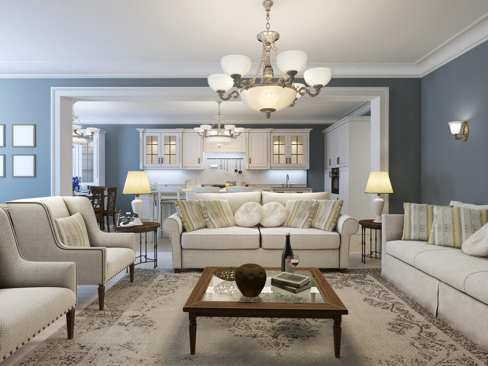 Large living room featuring classy seats, a fancy area rug and a gorgeous ceiling lighting, surrounded by blue walls.