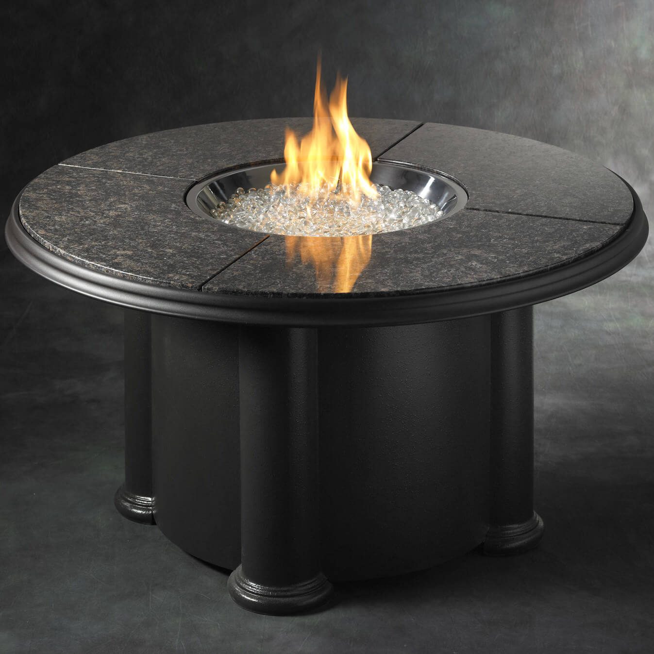 Classic is always the best and this black granite round table that reminds you of a Romanesque touch. It is made with stainless steel construction and has a heat capacity of over 60,000 BTUs. The crystals used for the fire pit are also of high quality and its controls are electronic so you can adjust your settings easily. It is perfect for indoor use.
