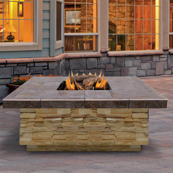 Enjoy the ambiance brought by this fire pit that can generate 55,000 BTU and help you relax on cool nights. This square fire pit looks very beautiful thanks to its tile countertop and elegant stone base. It also comes with its own fire log set and lava rocks depending on your preference.