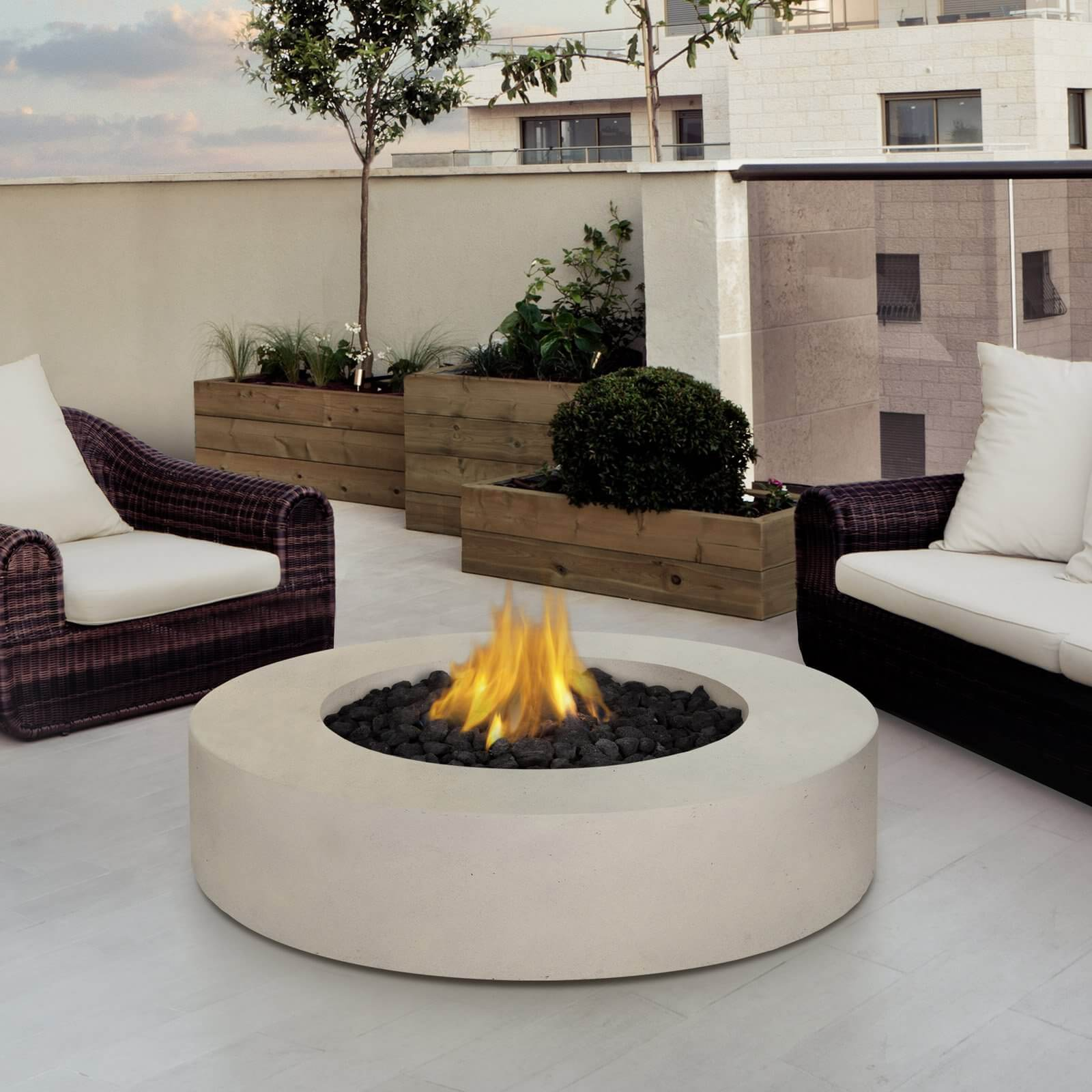 Want a simple and elegant fire pit table? Then why not get this white marble/granite one. It comes with its own lava stones and you can adjust its settings easily.