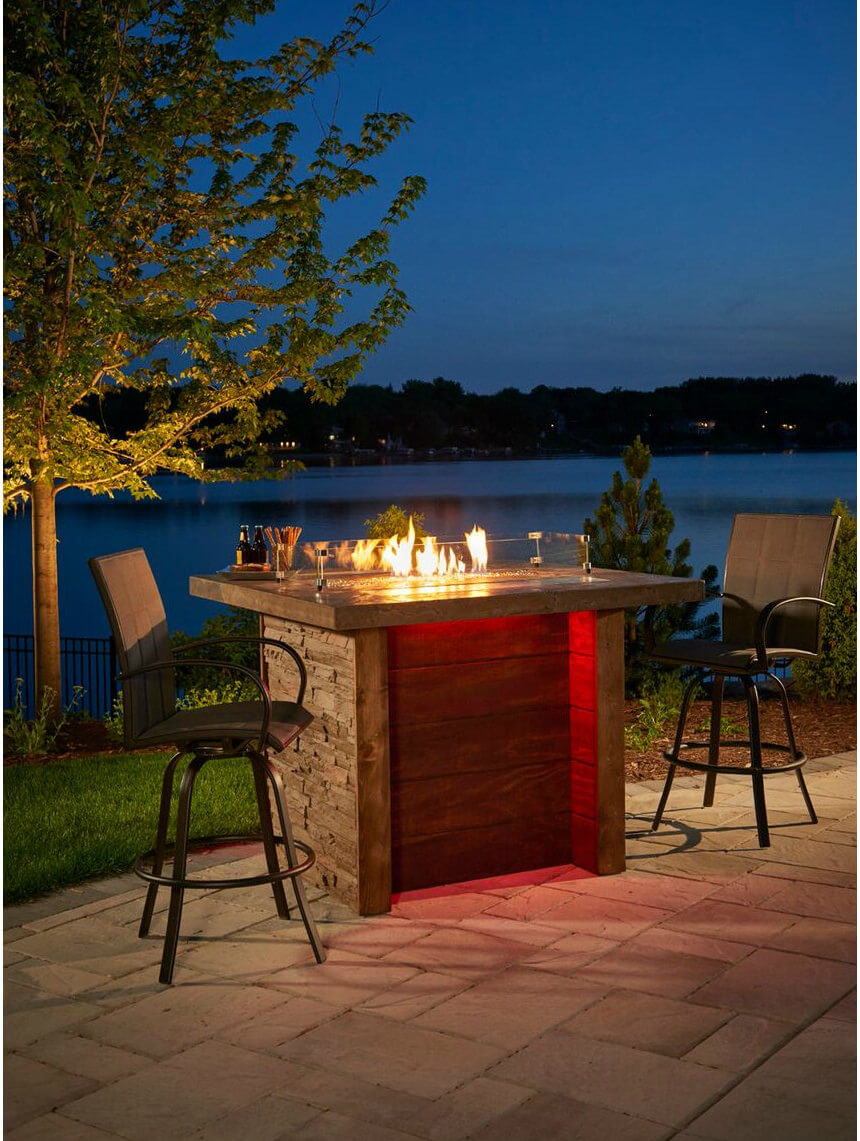 "Want a romantic fire pit in your back yard? Why not try out this tall ""bar style"" patio propane fire pit. This fire pit is guaranteed to draw a crowd since it is made with the best wood planks and faux stone finish and has LED lighting to add to the mood. Its burner has the capacity to reach up to 56,000 BTUs and you can store the propane tank in the enclosed base."