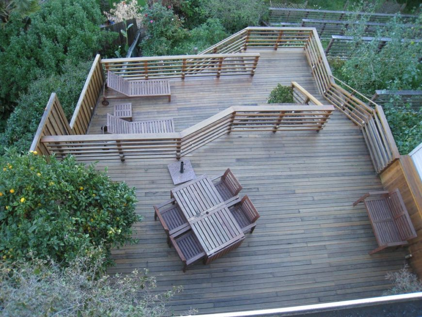 The sheer height of this deck allows occupants to see beyond the heavily landscaped gardens. The top tier features a dining area, while one of the lower tiers has lounge chairs for sunbathing.