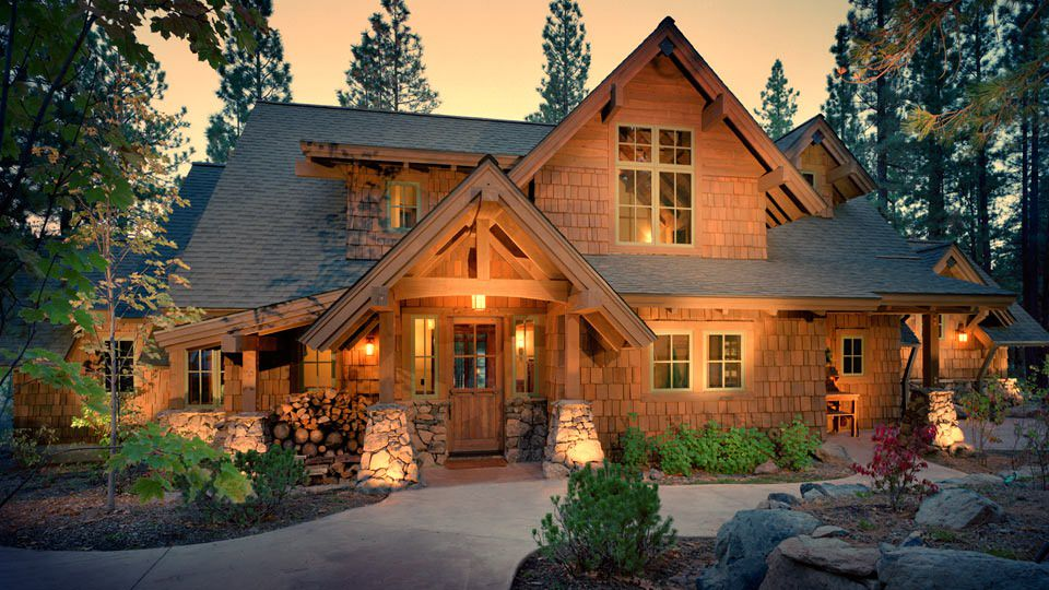 This rustic shingle home gives me a feeling of warmth and comfort with its cabin like exterior.