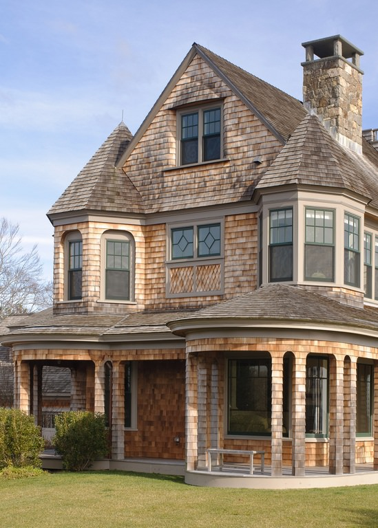 This home is a mix of architectural detail from its roof to the brick chimney. It looks like a home from a classic movie.