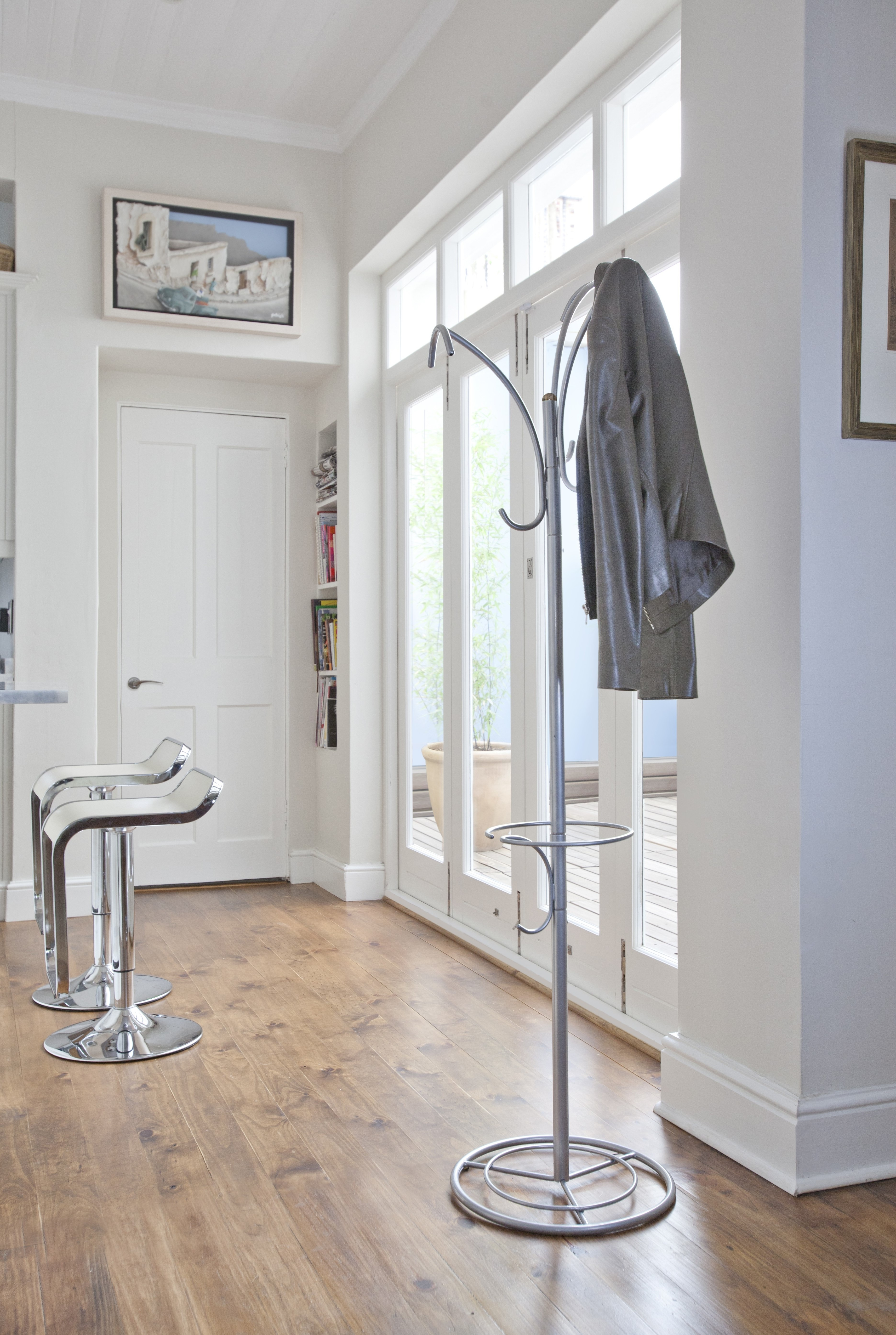 This modern style coat rack features 3 loops and 3 hooks at varying heights.