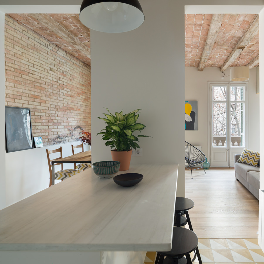 A functional kitchen working table hiding in between two passages from the dining area and living room.