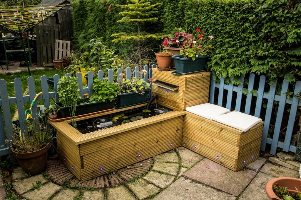 Much like raised gardens, this particular raised bed can be used as a water feature as shown, but it can also be used as a garden as well. This particular feature uses nice decking boards that have been kiln-dried and has wrap around seating.