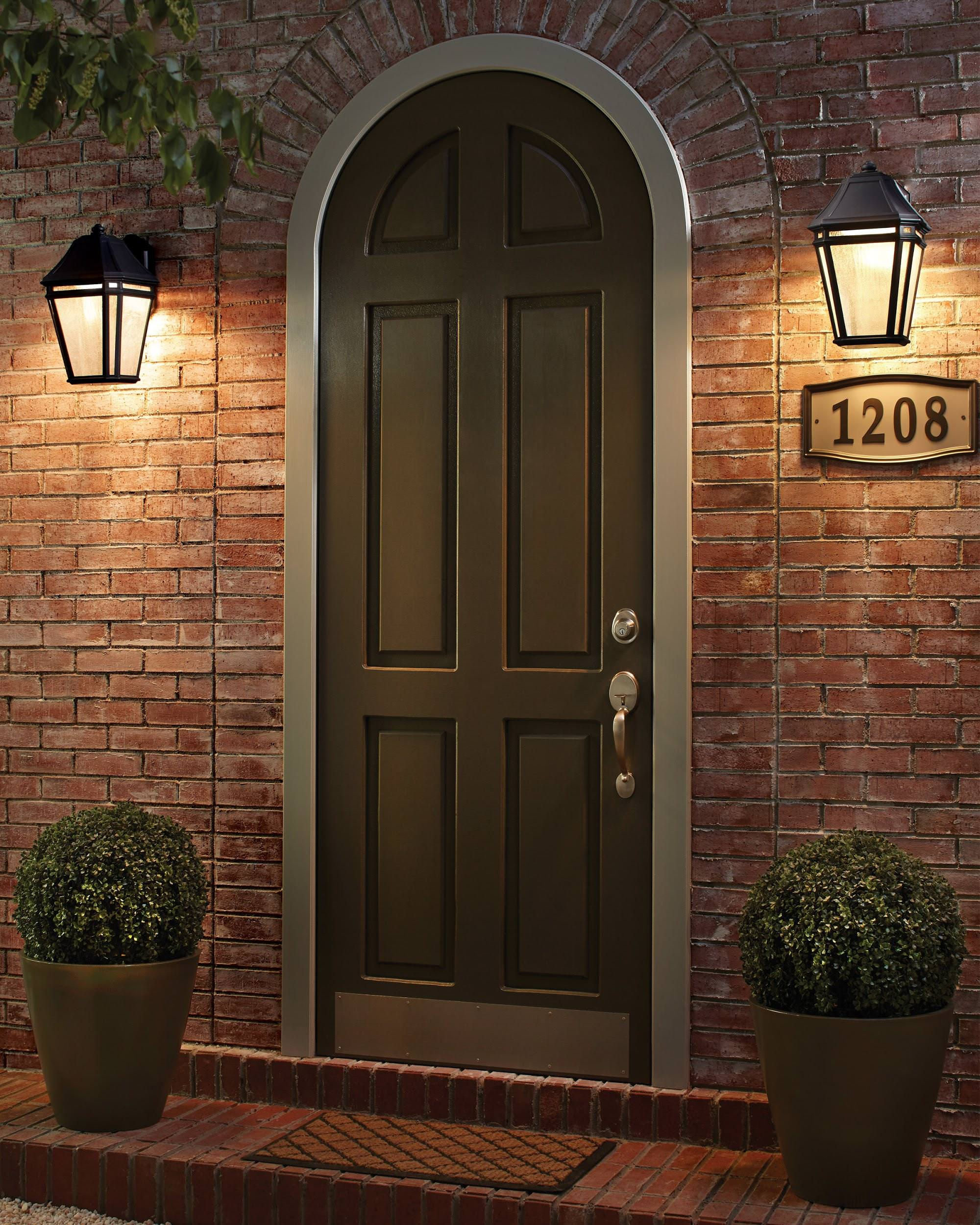 Front door with two wall-mounted lights.
