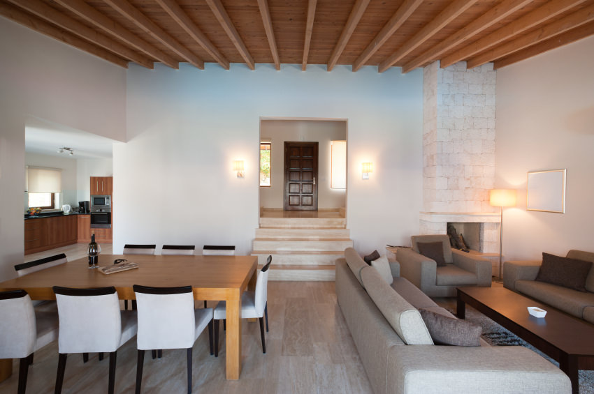 A modern touch in Mediterranean design where beams and ceiling give contrast to the neutral color of the wall and flooring.