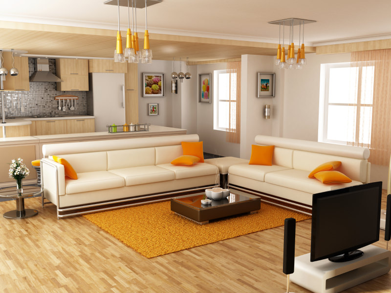 Some orange yellow throw pillows add a bright contrast to a warm toned interior. A few pendant lights, paintings and a floor rug supplement the orange accents in this simple yet fabulous looking living room. The silhouette curtains are in light orange too.