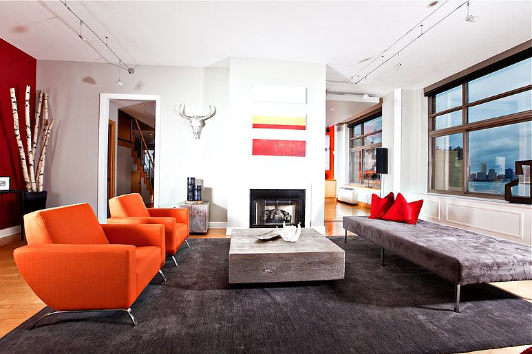 When you look at this, the first things to pop out as attractive are the ones in bright colors - especially the bright pair of armchairs and the red throw pillows opposite. Their looks are particularly emphasized in contrast with the grey.