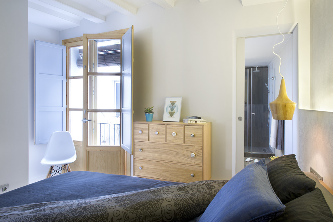 The wooden and glass door design gives a natural day light in the bedroom.