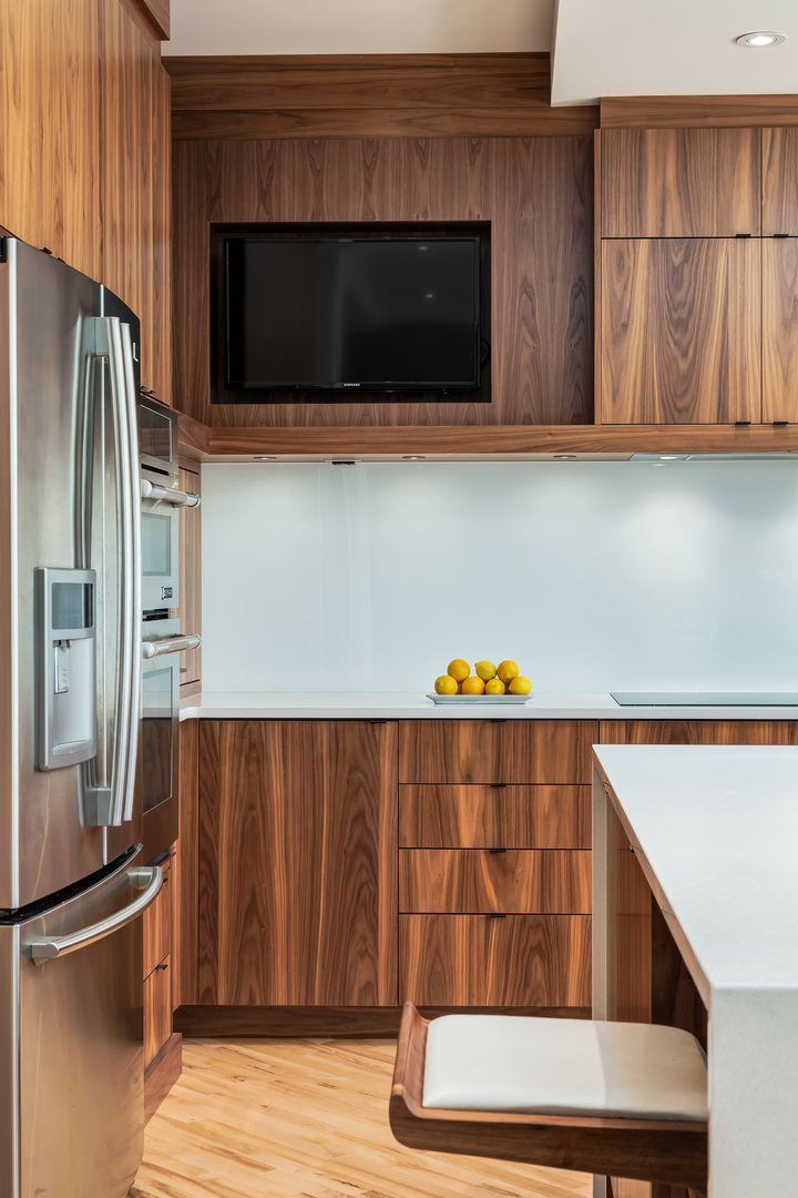 Built in appliances and plenty of storage space make this kitchen functional and clean.