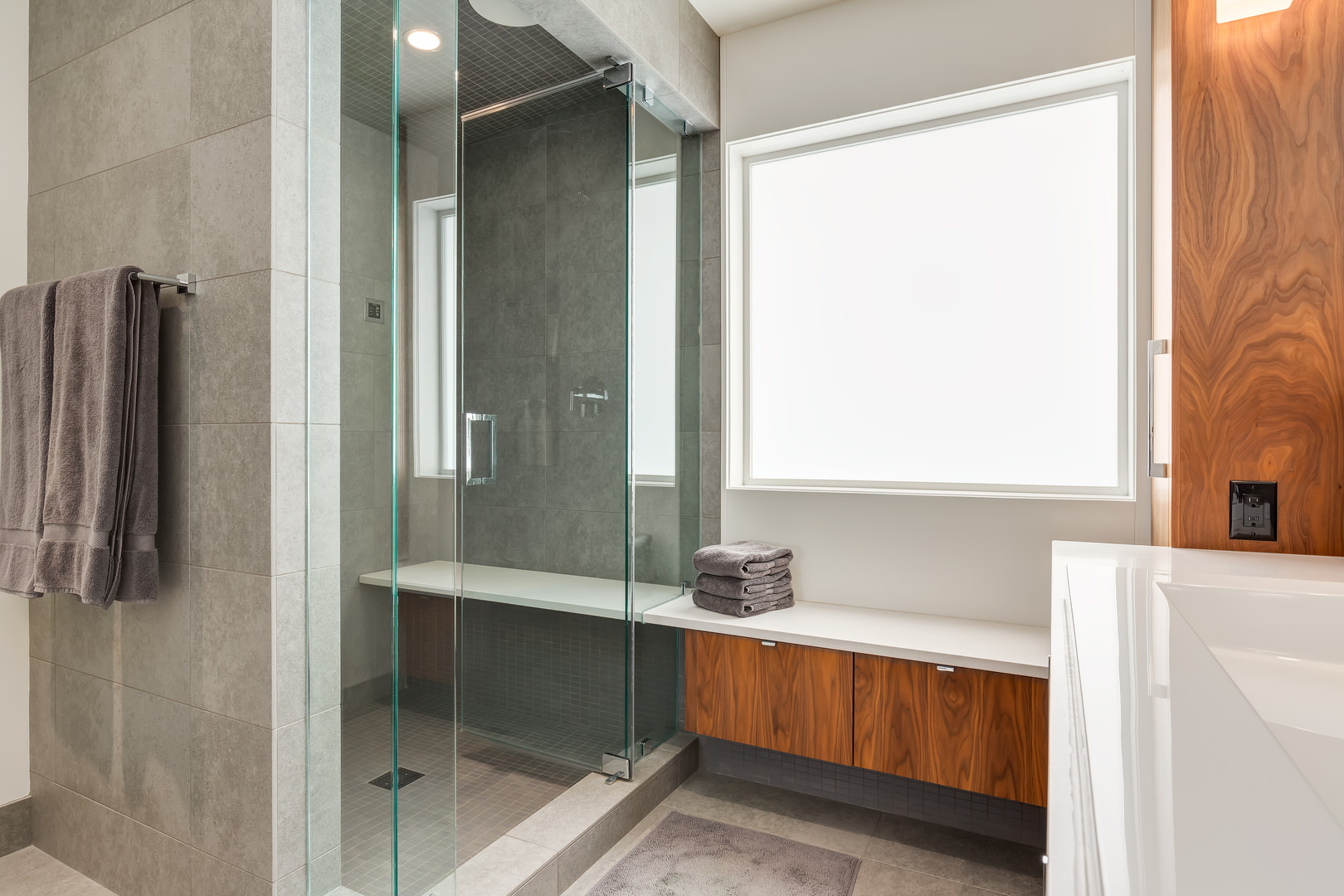 A bright and spacious bathroom is accented by natural lighting.
