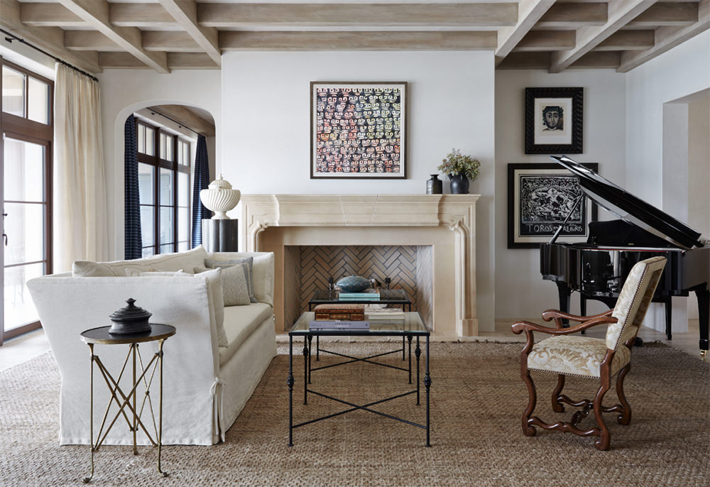 If you just look at it at first glance, you will mistaken this as an old fashioned traditional living space because of its warm atmosphere and furnishings. However, if you will examine this thoroughly you will then notice that some of its details are contemporary, like having a few metal accents on the tables, monochromatic tones and bare flooring covered with a rug. Not to forget the open and wide window that allows natural lighting, a few accessories, and the simple over exposed wood ceiling beams.