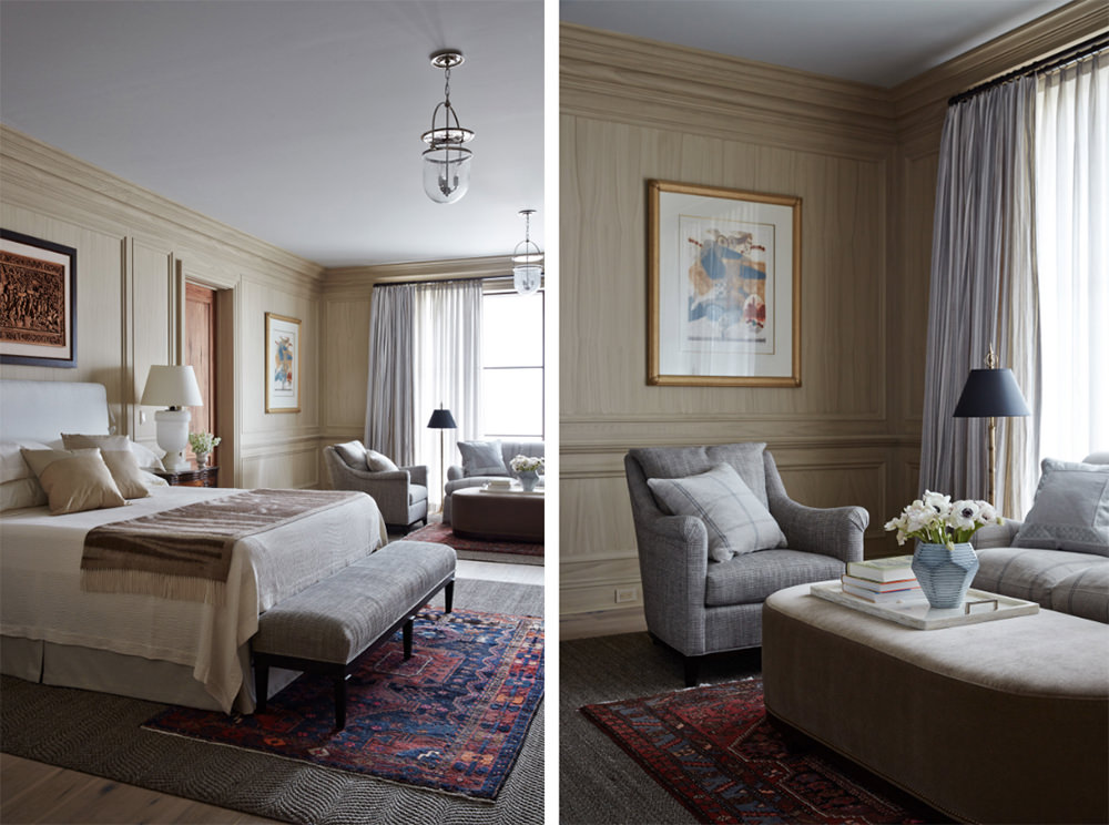 Warm tones are neutralized with added floor rug in bright blue and red patterns. The grey and dark shades of sofa chairs and bed room bench blends well. This is a bedroom and a living room combo. Simple lines, angles and forms are present though the coffered wall and ceiling moldings spot the difference.