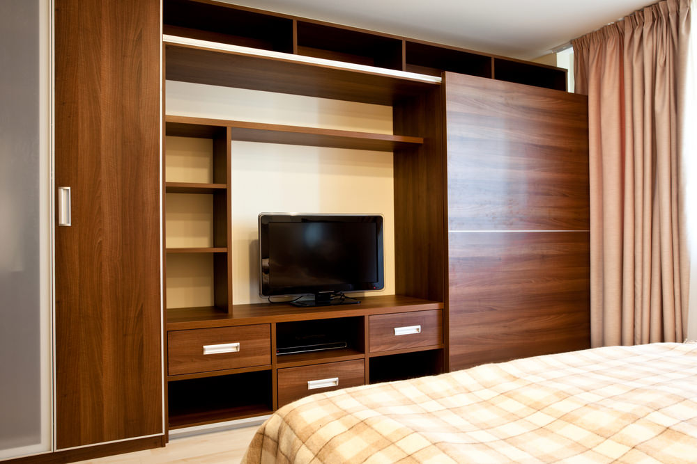 Adding full wall, floor-to-ceiling storage units is a very good use of bedroom space, especially smaller primary bedrooms.