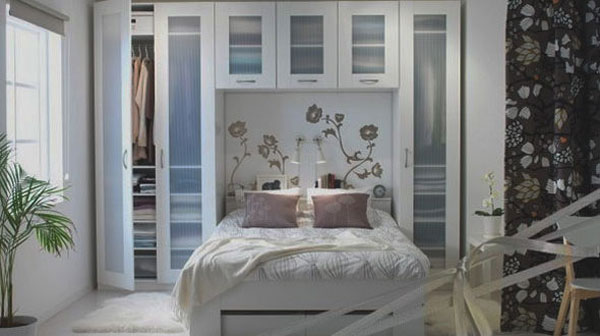 This is a terrific example of how to maximize the wall space surrounding and above a bed in a small bedroom.