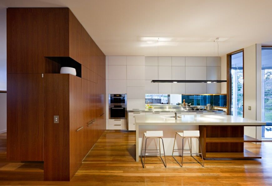 Modern kitchen design with double stainless steel wall oven.