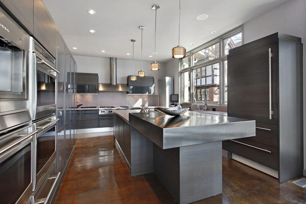 Chef's dream kitchen with stainless steel throughout and a THREE wall ovens