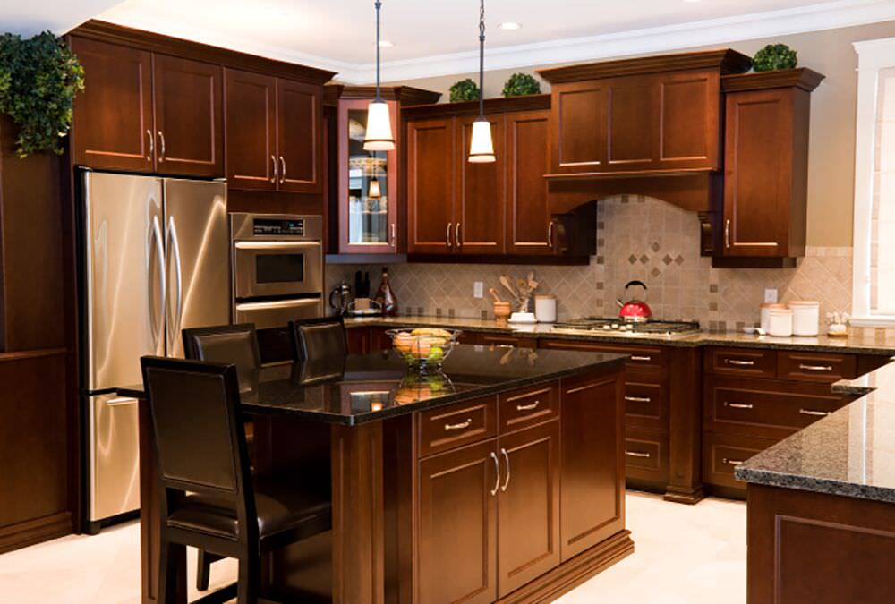 Rich wood make up this custom kitchen design with a double-wall oven directly adjacent to the refrigerator.
